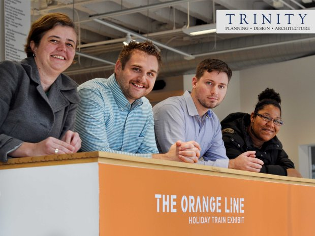 The Trinity design team shows off their model making skills for the 2015 Orange Line Holiday Train Exhibit.